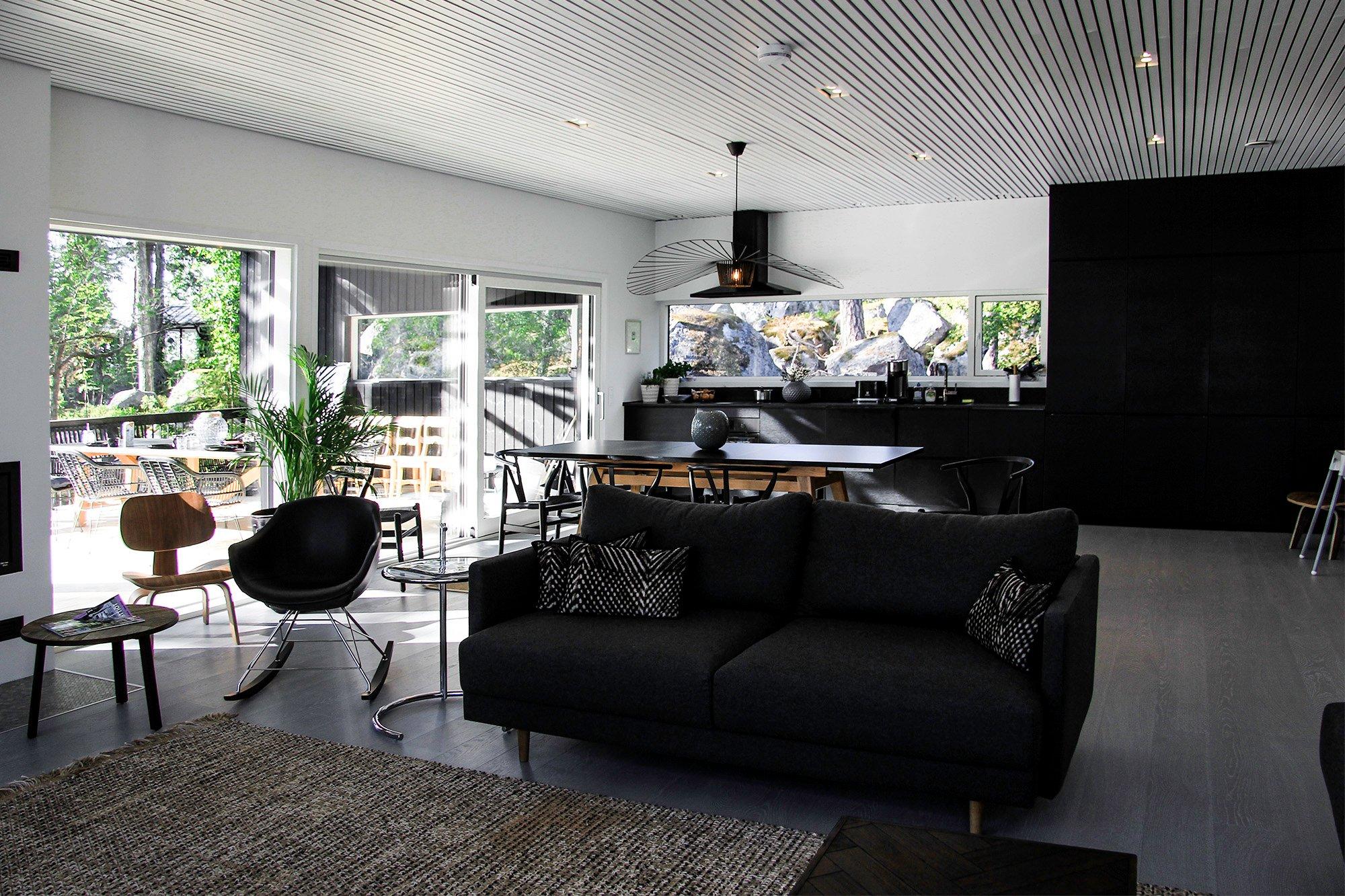 Moderni vapaa-ajan-asunto Helsingin saaristossa olohuone ja keittio-1